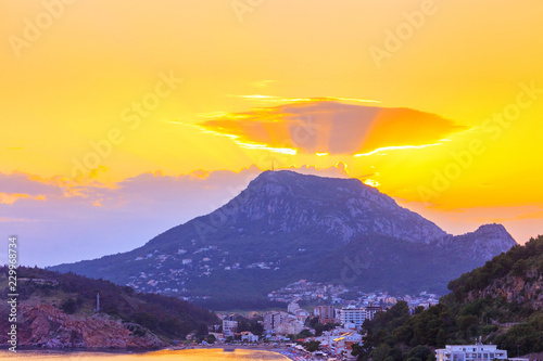 Foto auf Gartenposter Gelb Gold colored sunset on the Adriatic sea coastline with Sutomore city in Montenegro, gorgeous seascape