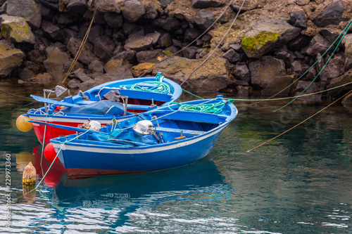 Two blue small fishing boats in greek style.
