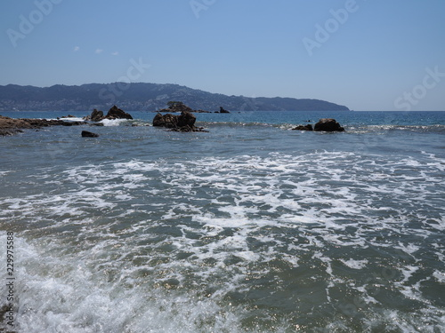 Fotografering  Panoramic scenery of rocks at bay of ACAPULCO city in Mexico with Pacific Ocean