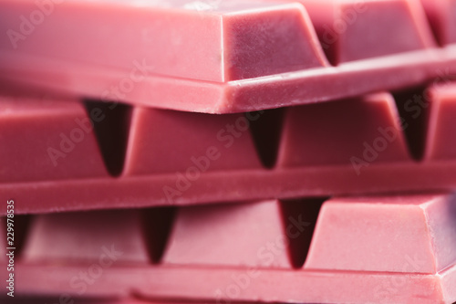 Foto auf Gartenposter Katze Finger Ruby Chocolate Bar made from ruby cocoa bean. New dimension of chocolate sweets.