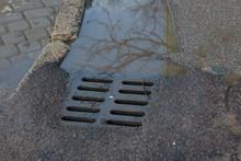 Rain Water Flows Down The Hatc...