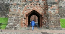 Carlisle Castle England Woman Walks Through Arch Entry. The Cathedral Church Of The Holy And Undivided Trinity. Cumbria, North West England. Founded As An Augustinian Priory.