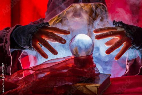 Obraz na plátně  a fortune teller reads from a crystal ball