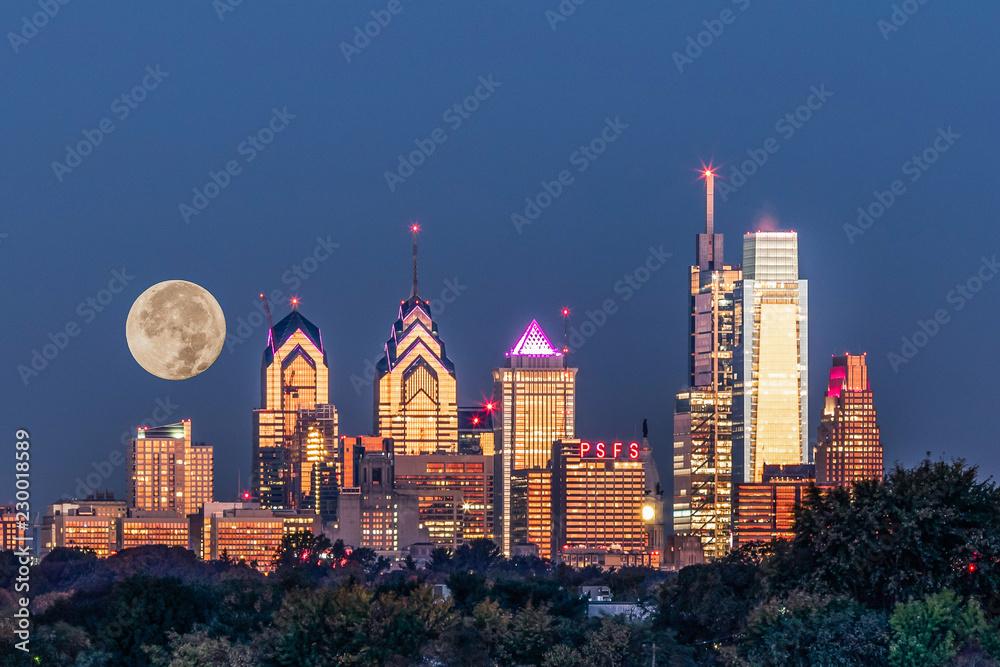 Full Moon setting behind Philadelphia