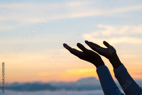 Photo woman hands praying to god  Woman Pray for god blessing to wishing have a better life