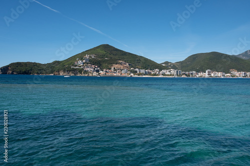 Spoed Foto op Canvas Stad aan het water Budva panorama view. The old Town. Blue summer sky over Adriatic Sea landscape. Montenegro. Europe.