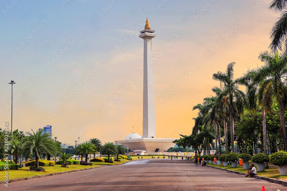 Fototapety, obrazy: Jakarta, Indonesia, national monument (Monas). The national monument, or Monas, is a 137-meter tower in the center of Jakarta, symbolizing Indonesia's struggle for independence.