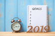 canvas print picture - 2019 Happy New years with Goals text on notebook, retro alarm clock and wooden number on table and copy space. Resolution, Mission and New Start Concept
