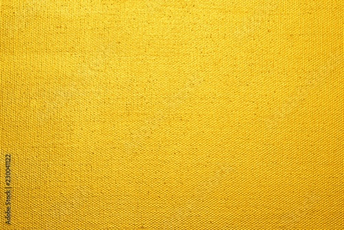 Obraz Goldgelb angemalte Leinwand als Hintergrund  - fototapety do salonu