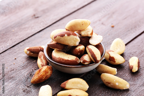 Para nuts on a rustic wooden table and para nuts in bowl