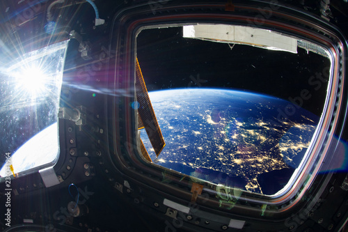 Collage image with huge US at night with city lights from the outer space from the ISS window. Elements of this image furnished by NASA.