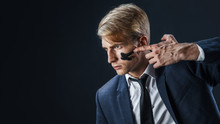 Businessman With War Paint On His Face. Risk Management Concept.