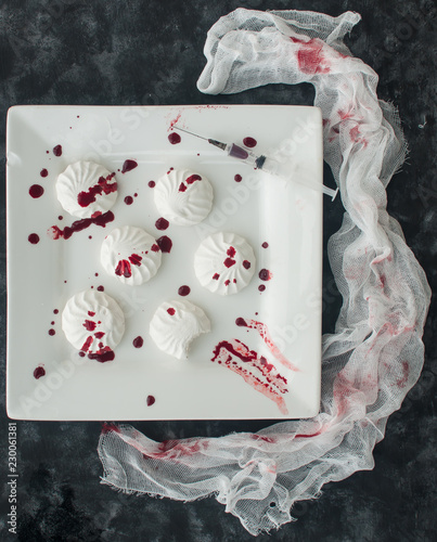 Marshmallow in drops of food coloring (like blood) in ...