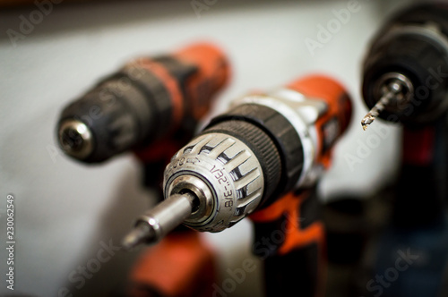 Fotografering Battery Drill Set orange and black seen close up blurred background