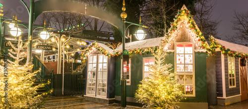 Photo  The carousel and christmas illumination in Tivoli Gardens, Compenhagen, Denmark