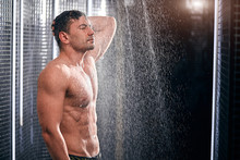 Close Up Of Sexually Attractive Handsome Nude Man Taking Shower And Feeling Tired And Exhausted After A Long Flight Trip Under Water Drops.