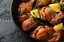 Roasted Boneless Skinless Chicken Thighs In Lemon And Thyme Dressing Served In Vintage Cast Iron Skillet, Frying Pan