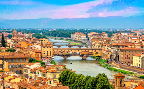 Photo Stands Florence Aerial view of medieval stone bridge Ponte Vecchio over Arno river in Florence, Tuscany, Italy. Florence cityscape. Florence architecture and landmark.