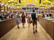Leinwandbild Motiv Oktoberfest, Munich, Germany. Waiter holding beers, tent interior background