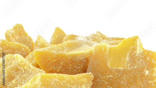 Photo Pieces of natural beeswax are isolated on a white background
