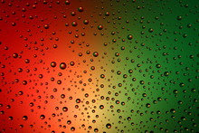 A Multicolored Background And Drops Of Water