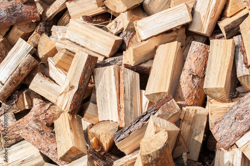 Fotoposter Brandhout textuur A pile of firewood from birch on the lawn Texture to Chop wood