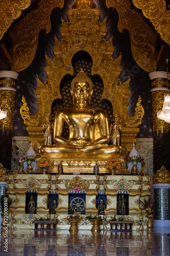 Fotografia  Golden is Buddha statue in Meditate of Thailand temple agent of Buddha In Buddhi