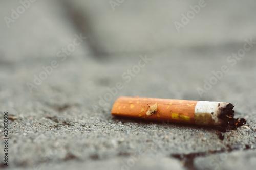 Photo  cigarettes stub on the street