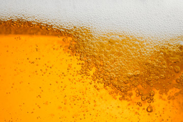 Beer background with bubble froth texture foam pouring alcohol soda in glass ...