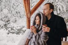 Stylish Couple Holding Hot Tea...
