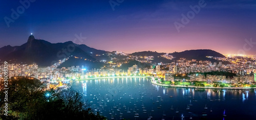 Panoramic aerial view of Rio de Janeiro and Guanabara Bay with Corcovado Mountain at night - Rio de Janeiro, Brazil