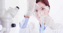 Woman Scientist Take Test Tube