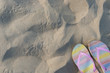 pair of slippers on sand