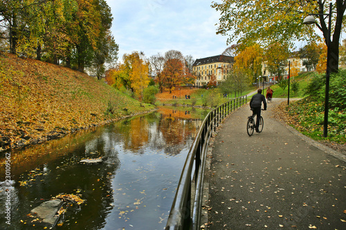 Walking path along the river in city in autumn Canvas Print