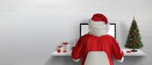 Santa Claus Working On A Compu...