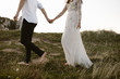 canvas print picture - couple walking and holding hands