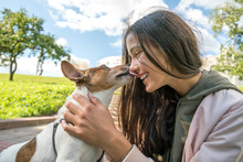 Young Teen Girl Hipster Kisses A Dog Jack Russell Terrier In The Park, Smile Close Up, Love And Friendship, Care For Animals