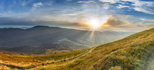 Sunset in the autumn in the mountains. Bieszczady National Park - Caryńska meadow - Poland.