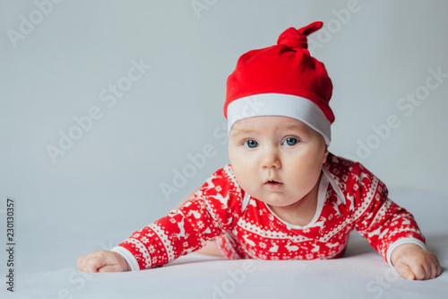 e293233b5 Cute little baby in santa hat on white background - Buy this stock ...