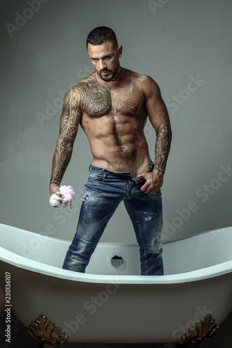 Fotografie, Obraz  Brutal handsome man with tattooed body