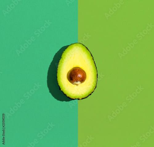 Fresh avocado on a green background flat lay Fototapeta