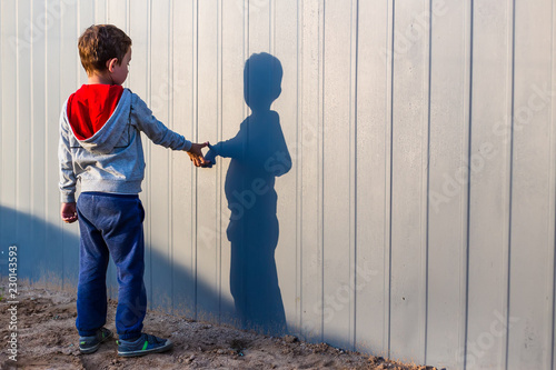 boy and his shadow Canvas Print