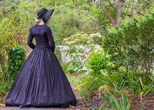 Victorian Woman In Black Ensemble Outdoors
