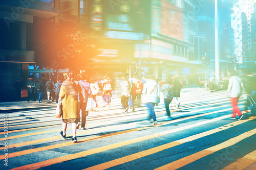 Fotomural walking people on the busy city street with sunlight effect