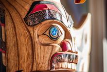 Totem Sculpture Art On Wood Pole In Alaska.