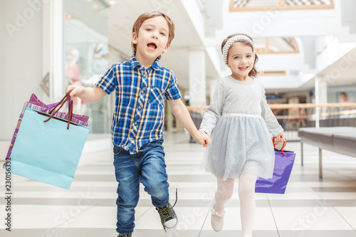 Fotografía  Group portrait of two cute adorable preschool children going shopping