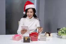 Happy Woman In Santa Hat Shopp...
