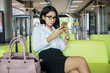 Businesswoman with smartphone in airport lounge
