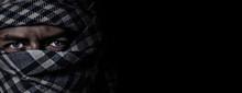 An Arab Face In A Scarf Keffiyeh On A Black Background