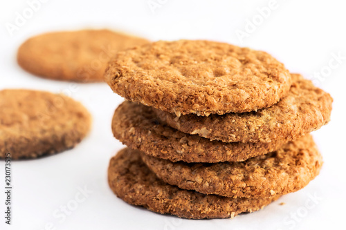 Deurstickers Koekjes Homemade shortbread cookies made of oatmeal are stacked on a white table background. Food snack concept and with copy space for text.